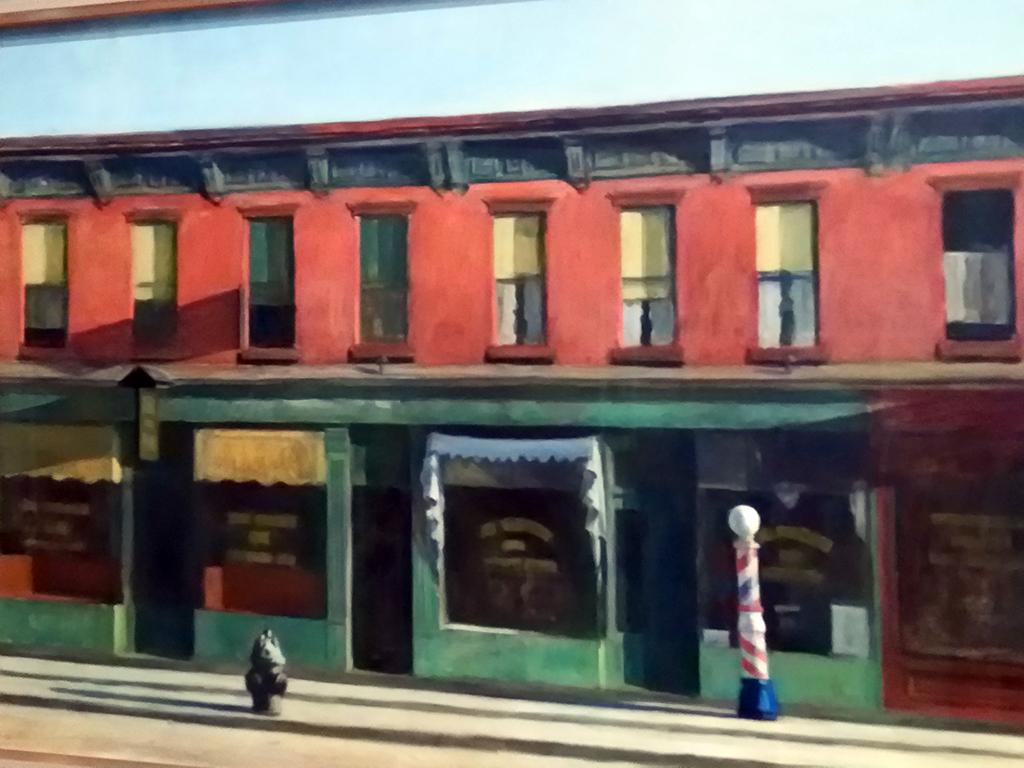 """Fotografía del cuadro de Edward Hopper: """"Domingo por la mañana"""" (1930) inspirado en una calle real de la avenida 7 del Greenwich Village reducida a su mínima expresión - Foto de AHM"""