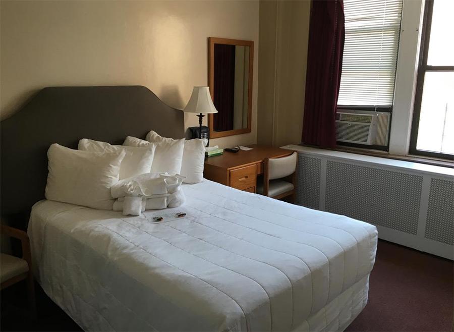 Habitación Hotel Leo House cortesía de Booking